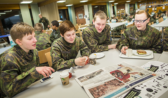 Four conscripts sit and chat